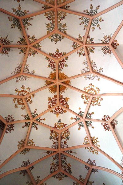 The pink and white ceiling with snowflake-like designs