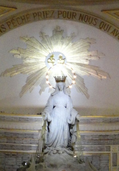 The white marble statue of the Blessed Virgin