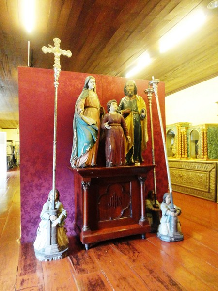 Statues of the Holy Family and processional crucifixes
