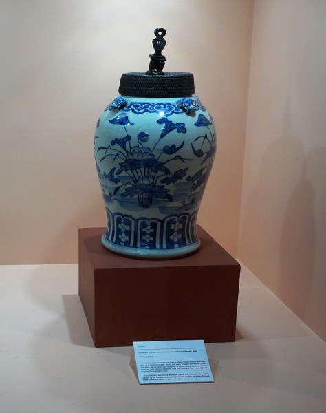 Ifugao porcelain wine jar with woven cover