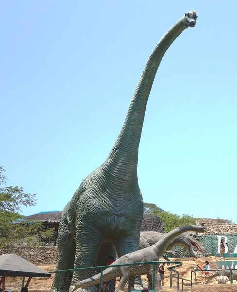 Life-size concrete dinosaurs