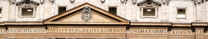 The inscription below the cornice on the 1 m. (3.3 ft.) tall frieze reads: IN HONOREM PRINCIPIS APOST PAVLVS V BVRGHESIVS ROMANVS PONT MAX AN MDCXII PONT VII In honour of the Prince of Apostles, Paul V Borghese, a Roman, Supreme Pontiff, in the year 1612, the seventh of his pontificate)