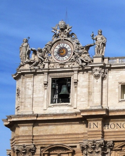 The clock on the left of the facade