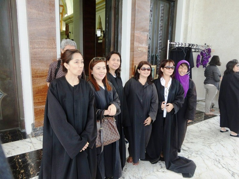 L-R: Dyan, Karren, Tess, Luchie, Erlie and Rosanna wearing black polyester robes required for entrance into the mosque